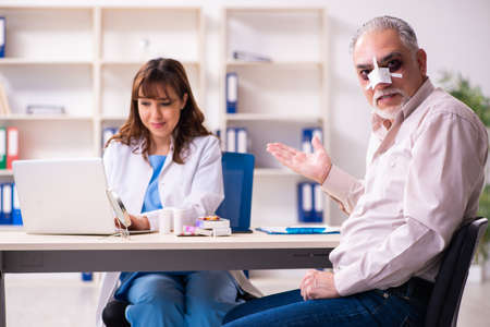 Old man visiting young female doctor for plastic surgery Stock fotó