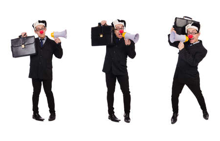Businessman clown with loudspeaker on white Banque d'images