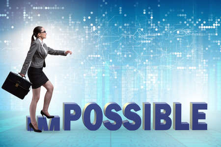 Businesswoman in impossible business concept