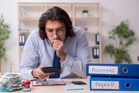 Young male financial manager in the office