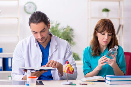 Two doctors colleagues working in the hospital
