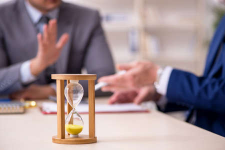 Two businessmen in time management concept
