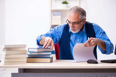 Old male author writing books