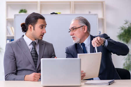 Old and young businessmen in business meeting concept Imagens