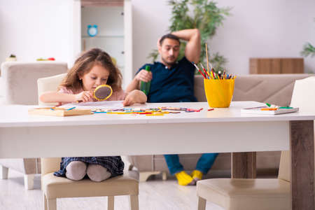 Drunk father and little girl indoors Stock Photo