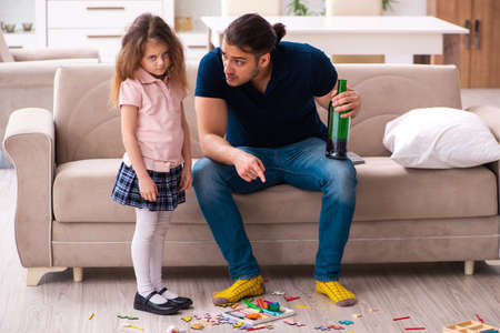 Drunk father and little girl indoors