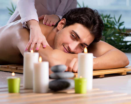 Young handsome man during spa procedure 版權商用圖片