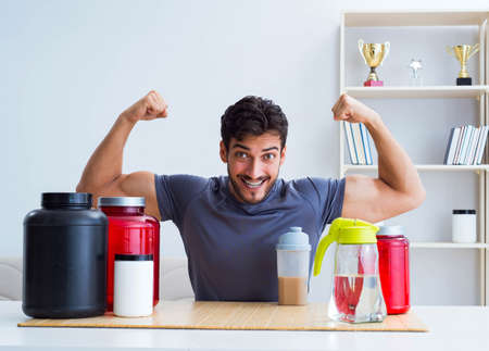 Athlete tasting new protein supplements for better muscles