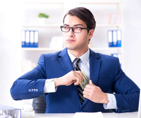 Businessman receiving his salary and bonus Imagens