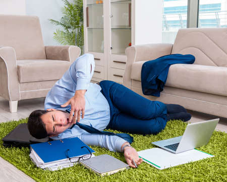 Tired and exhausted businessman relaxing after hard day