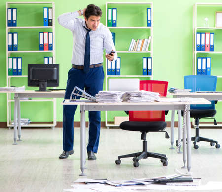 Frustrated businessman stressed from excessive work Imagens
