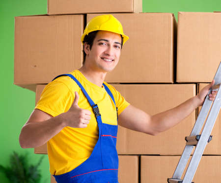 Man contractor working with boxes delivery Imagens