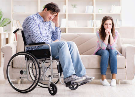 Desperate disabled person on wheelchair Imagens