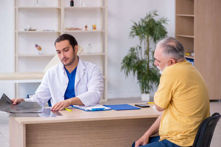 Old patient visiting young male doctor radiologist