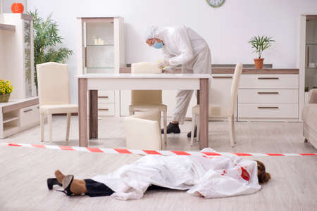 Forensic experts at the crime scene Stock Photo