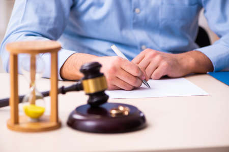 Young man in courthouse in divorcing concept
