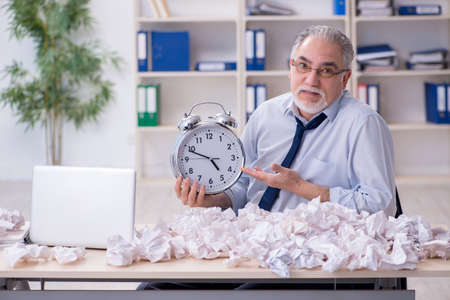 Old businessman rejecting new ideas with lots of papers Stok Fotoğraf