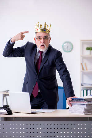 Old king businessman employee at workplace