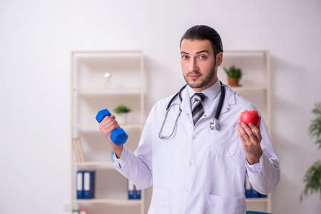 Young male doctor working in the clinic Standard-Bild