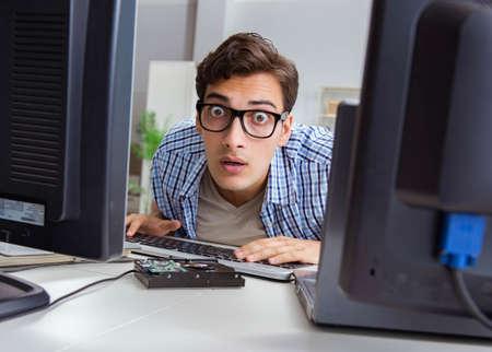 Young trader monitoring markets on screens