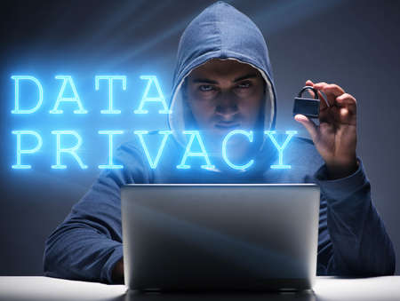 Data privacy concept with hacker stealing personal information Фото со стока