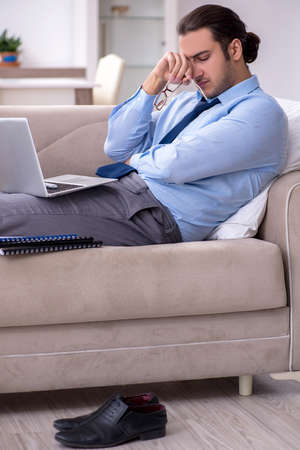 Tired businessman employee working from home Stock fotó