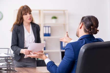Business meeting between businessman and businesswoman Stock fotó