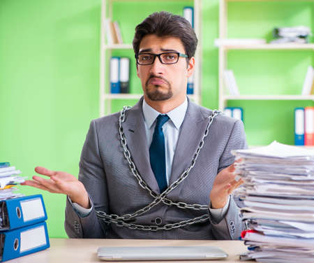 Employee chained to his desk due to workload