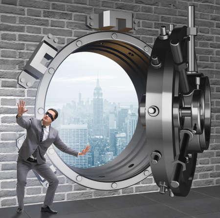 Blindfolded businessman in front ot vault door