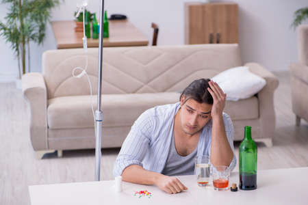 Young man in alcohol addiction treatment concept