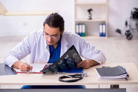 Young doctor working in the hospital