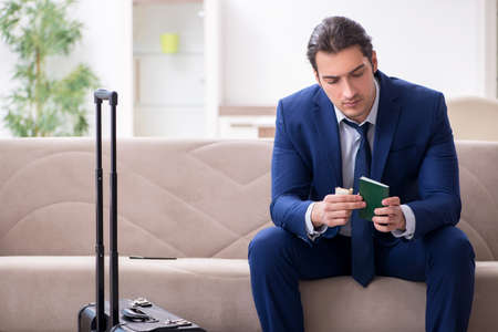 Young businessman holding passport preparing for trip
