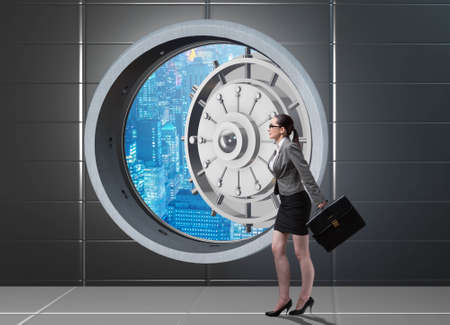 Businesswoman walking towards open vault door
