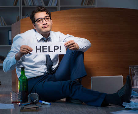 Employee asking for help and drinking under stress and despair