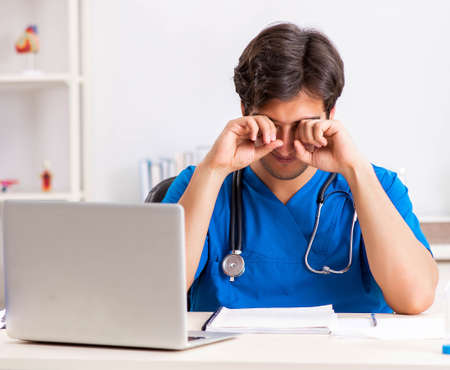 Young doctor working in the hospital Stock Photo