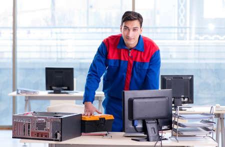 Computer repairman specialist repairing computer desktop Foto de archivo