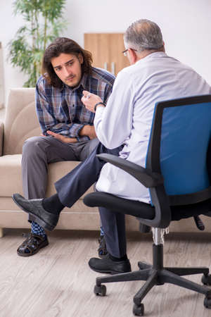Young male patient visiting experienced doctor psychiatrist
