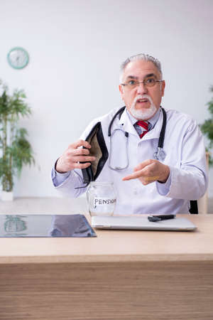 Old male doctor in retirement concept