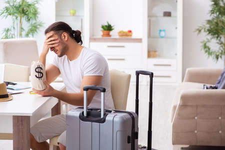 Young man preparing for departure at home