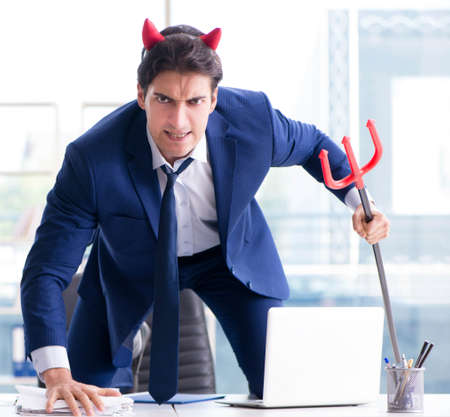 Devil angry businessman in the office