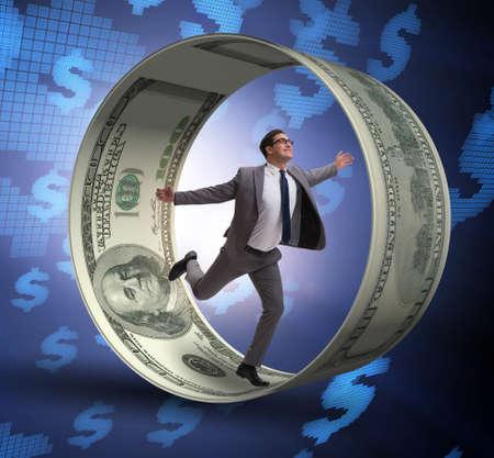 The businessman in hamster wheel chasing dollars Foto de archivo