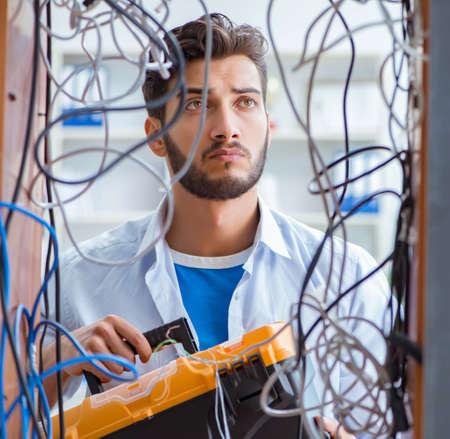 Computer repairman working on repairing network in IT workshop