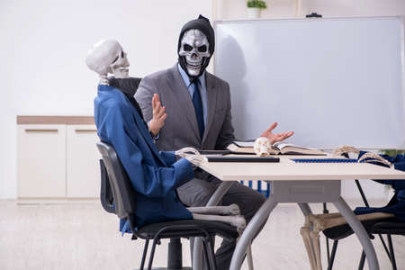 Funny business meeting with devil and skeletons