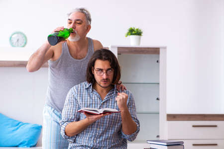 Young son student and dad alcoholic