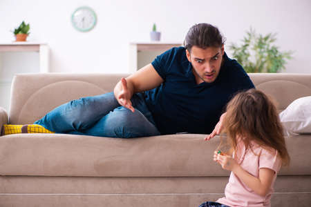 Young father and little girl indoors