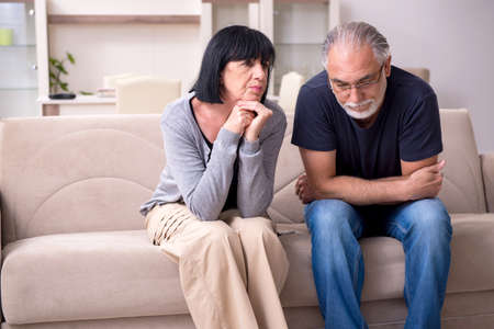 Old couple having argument at home