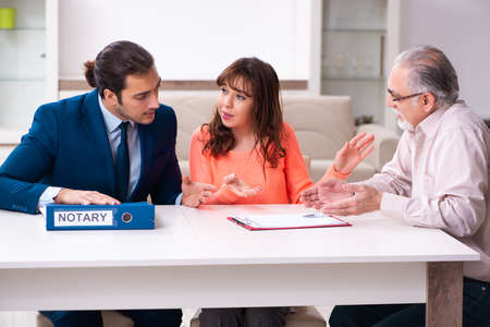 Young male lawyer, old man and his granddaughter in testament co Stock Photo