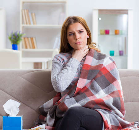 Sick woman suffering from flu at home