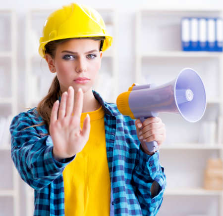 The angry building supervisor with megaphone Stock Photo