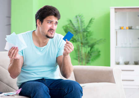 Young man struggling with personal finance and bills Stock Photo